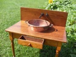bathroom vanity artform, bathroom vanity from copper pot, repurposed materials for bathroom vanity,