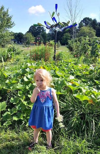 Olivia, in front of one of our vegetable gardens. Obviously weeding still isn't a priority.
